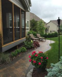 Backyard walkway with lounge chairs